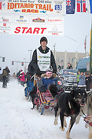 Honorary Musher Jan Newton and team leave the ceremonial start line at 4th Avenue and D street in downtown Anchorage during the 2013 Iditarod race. Photo by Jim R. Kohl/IditarodPhotos.com