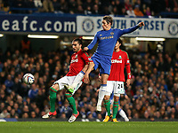 Wednesday 09 January 2013<br /> Pictured L-R: Chico Flores of Swansea challenged by Fernando Torres of Chelsea<br /> Re: Capital One Cup semifinal, Chelsea FC v Swansea City FC at the Stamford Bridge Stadium, London.