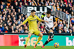 GonCalo Manuel Ganchinho Guedes of Valencia CF (R) fights for the ball with Antonio Rukavina of Villarreal CF  (L) during the La Liga 2017-18 match between Valencia CF and Villarreal CF at Estadio de Mestalla on 23 December 2017 in Valencia, Spain. Photo by Maria Jose Segovia Carmona / Power Sport Images