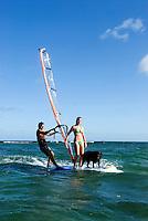 Couple & dog windsurfing together, Oahu, Hawaii.   Early 30's, caucasian.