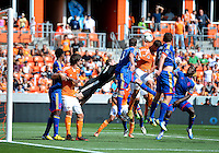 April 28, 2013: Colorado Rapids defender Drew Moor #3 grabs jersey of Houston Dynamo forward Will Bruin #12 during a corner kick in the first half of Major League Soccer match in Houston  TX. Houston Dynamo draw 1-1 against Colorado Rapids.