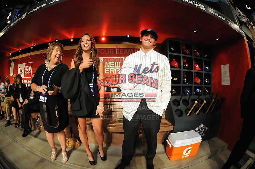 Shortstop Gavin Cecchini (Barbe H.S.) the number tweleve overall pick to the New York Mets with mom and girlfriend during the MLB Draft on Monday June 04,2012 at Studio 42 in Secaucus, NJ.   (Tomasso DeRosa / Four Seam Images)