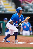 Oklahoma City Dodgers second baseman Willie Calhoun (4) hits a single during a game against the Colorado Springs Sky Sox on June 2, 2017 at Chickasaw Bricktown Ballpark in Oklahoma City, Oklahoma.  Colorado Springs defeated Oklahoma City 1-0 in ten innings.  (Mike Janes/Four Seam Images)