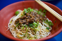 Beef-topped fresh wheat noodles in a tiny eatery in Taipei, Taiwan.