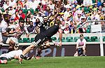Scott Curry passes. All Blacks Sevens beat Japan 26-14. 16 May 2015. Twickenham, London, England. Photo: Marc Weakley