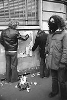 - Milano, Dicembre 1975, durante una manifestazione giovani di estrema sinistra  strappano manifesti del partito fascista MSI (Movimento Sociale Italiano)<br /> <br /> - Milan, December 1975, during a demonstration, extreme left-wing young people tear up posters of the fascist party MSI (Italian Social Movement).