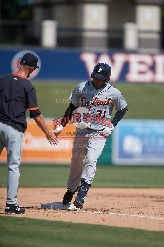 Detroit Tigers coach Gary Cathcart congratulates Jose De La Cruz (31) as he rounds the bases after hitting a home run during a Florida Instructional League intrasquad game on October 24, 2020 at Joker Marchant Stadium in Lakeland, Florida.  (Mike Janes/Four Seam Images)
