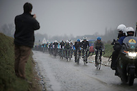 Dwars Door Vlaanderen 2013.Holleweg cobbles for the peloton