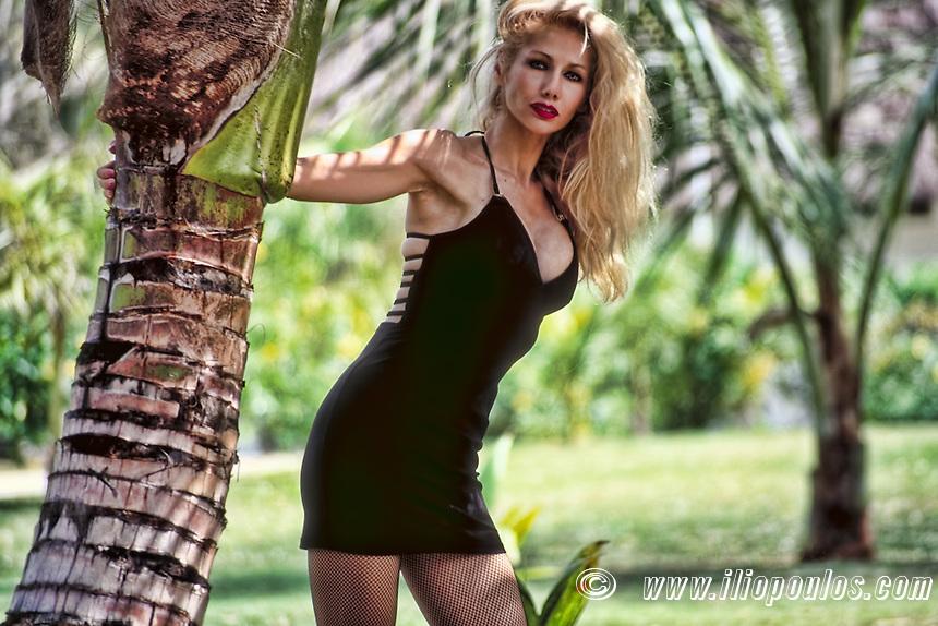 Beautiful young blond woman posing