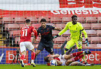 21st November 2020, Oakwell Stadium, Barnsley, Yorkshire, England; English Football League Championship Football, Barnsley FC versus Nottingham Forest; Michal Helik of Barnsley protects his face as a shot comes in to the penalty area and Conor Chaplin of Barnsley  and Tobias Figueiredo of Nottingham Forrest attack the ball