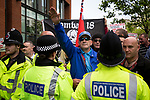 """© Joel Goodman - 07973 332324 . 22/08/2015 . Manchester , UK . A far-right protester performs a Nazi salute . Far-right nationalist group , """" North West Infidels """" and Islamophobic , anti-Semitic and white supremacist supporters , hold a rally in Manchester City Centre . Photo credit : Joel Goodman"""