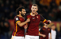 Calcio, Serie A:  Roma vs Palermo. Roma, stadio Olimpico, 21 febbraio 2016. <br /> Roma's Edin Dzeko, right, is hugged by teammate Mohamed Salah after scoring during the Italian Serie A football match between Roma and Palermo at Rome's Olympic stadium, 21 February 2016.<br /> UPDATE IMAGES PRESS/Riccardo De Luca