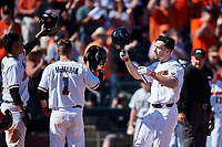 Oregon State Beavers Alex McGarry (44) is congratulated by Micah McDowell (12), and Kyler McMahan (1) after hitting a home run during an NCAA game against the New Mexico Lobos at Surprise Stadium on February 14, 2020 in Surprise, Arizona. (Zachary Lucy / Four Seam Images)