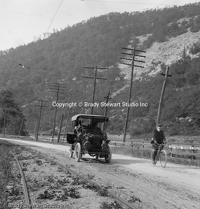 East McKeesport PA:  Brady Stewart's new 1906 Buick Model F driving along the railroad tracks and sharing the road with a bicycle.