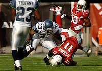Nov. 6, 2005; Tempe, AZ, USA; Wide receiver (11) Larry Fitzgerald of the Arizona Cardinals is upended by Seattle Seahawks safety (33) Marquand Manuel at Sun Devil Stadium. Mandatory Credit: Mark J. Rebilas