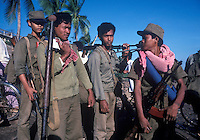 Cambodian government soldiers search for Khmer Rouge