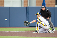 Michigan Wolverines third baseman Jake Bivens (18) fields a ground ball against the Eastern Michigan Hurons on May 3, 2016 at Ray Fisher Stadium in Ann Arbor, Michigan. Michigan defeated Eastern Michigan 12-4. (Andrew Woolley/Four Seam Images)