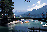 France, Annecy, Haute-Savoie, Rhone-Alpes, Europe, Pedestrian bridge crosses the Vasse canal on scenic Lake Annecy (Lac d' Annecy) surrounded by mountains in Annecy. France, Annecy, Haute-Savoie, Rhone-Alpes, Europe, Pedestrian bridge crosses the Vasse canal on scenic Lake Annecy (Lac d' Annecy) surrounded by mountains in Annecy.