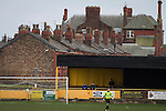 Prescot Cables 2 Brighouse Town 1, 13/02/2016. Hope Street, Northern Premier League. Spectators in the shed behind the goal watching on as Prescot Cables take on Brighouse Town in a Northern Premier League division one north fixture at Valerie Park. Founded in 1884, the 'Cables' in their name came from the largest local employer, British Insulated Cables and they have played in their current ground, also known as Hope Street, since 1906. Prescott won the match 2-1 watched by a crowd of 189. Photo by Colin McPherson.