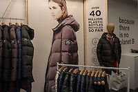 """A picture taken on November 11, 2015 shows clothes made from recycled waste in a shop of Madrid. Ecoalf, a Spanish Madrid-based firm founded in 2010, has already launched """"a new generation"""" of clothes and accessories made from plastic bottles, old fishing nets and used tires found on land.   © Pedro ARMESTRE"""