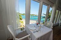 Honduras, Roatan Island, Fantasy Island Resort, Caribbean. Formal indoor dining room at the hotel.