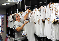 Saturday, 06 June 2015<br /> Pictured: A man chooses one of the adult size shirts<br /> Re: Swansea City FC new home kit launch at the club shop of the Liberty Stadium, south Wales, UK.