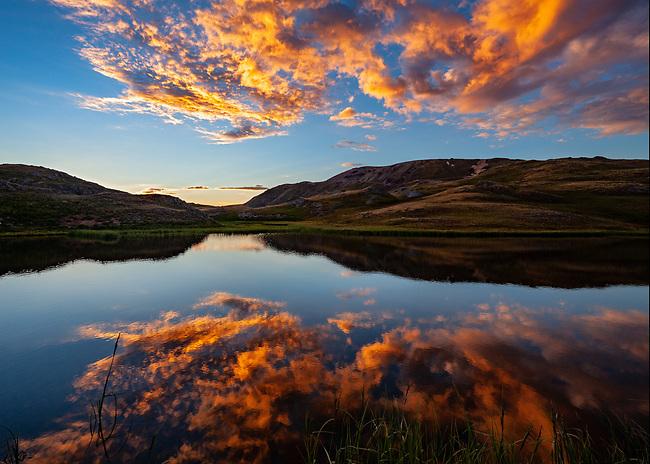 Summer sunset reflection on an alpine tarn, near little Engineer Pass