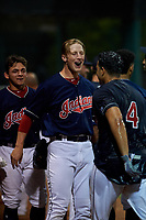 AZL Indians Red Will Bartlett (12) celebrates with Christian Cairo (8) and Yainer Diaz (4) after an Arizona League game against the AZL Padres 1 on June 23, 2019 at the Cleveland Indians Training Complex in Goodyear, Arizona. AZL Indians Red defeated the AZL Padres 1 3-2. (Zachary Lucy/Four Seam Images)
