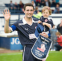 Laurie Ellis comes on to the field with his daughter Ava (2.5) at the start of his testimonial against Hearts'