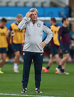 England manager Roy Hodgson scratches his head during training ahead of tomorrow's Group D match vs Uruguay