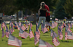 An unidentified couple wander through the veterans section of the Lone Mountain Cemetery in Carson City, Nev., on Sunday, May 25, 2014, in advance of Monday's Memorial Day ceremony.<br /> Photo by Cathleen Allison