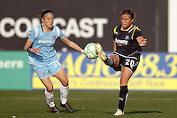 Camille Abily (20) of the Los Angeles Sol is defended by Julianne Sitch (38) of Sky Blue FC. The Los Angeles Sol defeated Sky Blue FC 2-0 during a Women's Professional Soccer match at TD Bank Ballpark in Bridgewater, NJ, on April 5, 2009. Photo by Howard C. Smith/isiphotos.com