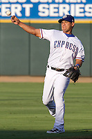 Round Rock Express shortstop Luis Hernandez #9 warms up before the Pacific Coast League baseball game against the Las Vegas 51s on August 7th, 2012 at the Dell Diamond in Round Rock, Texas. The Express defeated the 51s 5-4. (Andrew Woolley/Four Seam Images).
