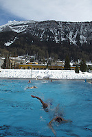 Switzerland. Canton of Wallis. Leukerbad. Leukerbad, also called Loèche-Les-Bains, is the ideal place for health-conscious guests. With its health centre like the Burgerbad, featuring Europe's largest alpine thermal bath facilities, the area beckons guests to rest and relax. Each day, some 3.9 million litres of water flow from the Leukerbad springs to various baths. An elixir of life is Valais water, where tourists and locals immerse themselves in an inexhaustible source of well-being. Italian tourists do the crawl. © 2005 Didier Ruef