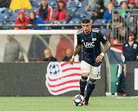 FOXBOROUGH, MA - JULY 17: Gustavo Bao #7 dribbles at midfield during a game between Vancouver Whitecaps and New England Revolution at Gillette Stadium on July 17, 2019 in Foxborough, Massachusetts.