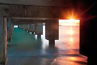 Sunset on underneath part of Hanalei Warf, Kauai, Hawaii.