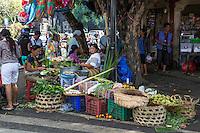 Bali, Indonesia.  Jimbaran Market Spills out onto the Street Corner.