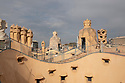 """Spain - Barcelona - Rooftop of Casa Milà, popularly known as La Pedrera or """"The stone quarry"""", a reference to its unconventional rough-hewn appearance, a modernist building. It was the last private residence designed by architect Antoni Gaudí and was built between 1906 and 1912.<br /> <br /> The building was commissioned in 1906 by Pere Milà and his wife Roser Segimon. At the time, it was controversial because of its undulating stone facade, twisting wrought iron balconies and designed by Josep Maria Jujol. Several structural innovations include a self-supporting stone façade, and a free-plan floor, underground garage and the spectacular terrace on the roof.<br /> <br /> In 1984, it was declared a World Heritage Site by UNESCO."""