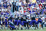 TCU Horned Frogs place kicker Jaden Oberkrom (33) and Texas Tech Red Raiders defensive lineman Gary Moore (5) in action during the game between the Texas Tech Red Raiders and the TCU Horned Frogs at the Amon G. Carter Stadium in Fort Worth, Texas. TCU defeats Texas Tech 82 to 27.