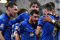 Jorge Luiz Frello Filho Jorginho of Italy (R) celebrates with Alessandro Florenzi and other team mates after scoring the goal of 1-0 during the Uefa Nation League Group Stage A1 football match between Italy and Poland at Citta del Tricolore Stadium in Reggio Emilia (Italy), November, 15, 2020. Photo Andrea Staccioli / Insidefoto
