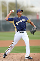 Amaury Rivas #47 of the Milwaukee Brewers participates in pitchers fielding practice during spring training workouts at the Brewers complex on February 18, 2011  in Phoenix, Arizona. .Photo by Bill Mitchell / Four Seam Images.