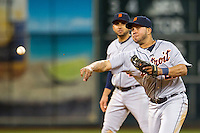 Detroit Tigers shortstop Jhonny Peralta (27) makes a throw to first base during the MLB baseball game against the Houston Astros on May 3, 2013 at Minute Maid Park in Houston, Texas. Detroit defeated Houston 4-3. (Andrew Woolley/Four Seam Images).