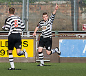 Kevin Turner celebrates after he scores Shire's first goal ...