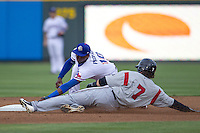 Round Rock second baseman Jurickson Profar (10) tags Nashville base runner Sean Halton (7) at second base during the Pacific Coast League baseball game against the Nashville Sounds on May 4, 2013 at the Dell Diamond in Round Rock, Texas. Round Rock defeated Nashville -6. (Andrew Woolley/Four Seam Images).