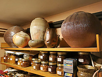 BNPS.co.uk (01202 558833)<br /> Pic: AdamPartridgeAuctioneers/BNPS<br /> <br /> Pictured: The food pantry was full of pots <br /> <br /> A huge collection of pottery and ceramics found stacked inside the suburban home of an elderly couple has sold for almost £200,000.<br /> <br /> Leonard and Alison Shurz filled every room of their three bed house with ceramic pieces they had gathered from all over the world.<br /> <br /> The Aladdin's Cave of pots, bowls, plates, vases and jugs was found by a stunned auctioneer who had the daunting task of cataloguing it all.