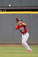 Memphis Redbirds outfielder Thomas Pham #27 makes a catch during the Pacific Coast League baseball game against the Round Rock Express on April 24, 2014 at the Dell Diamond in Round Rock, Texas. The Express defeated the Redbirds 6-2. (Andrew Woolley/Four Seam Images)