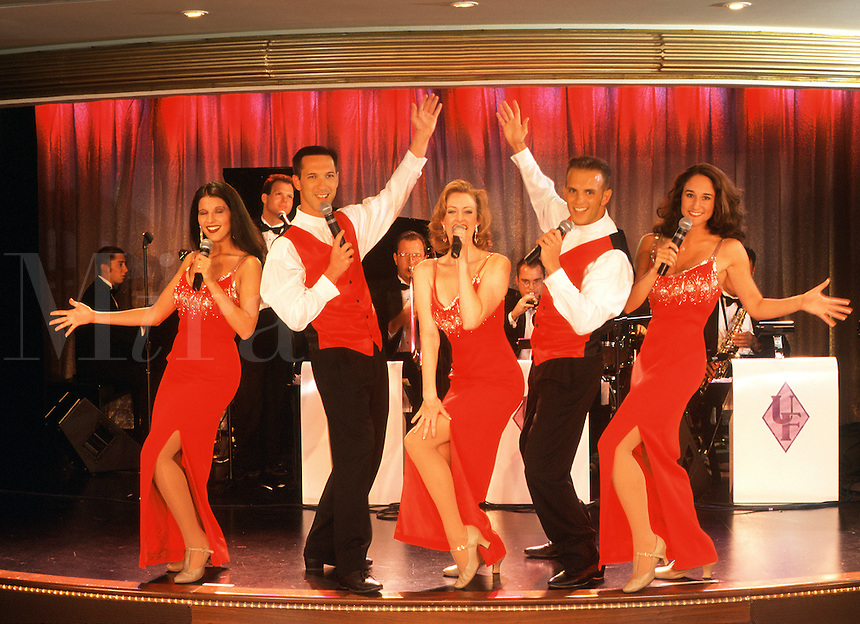 Singers, dancers and musicians in cruise ship show