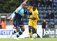 Michael Duberry of Wycombe Wanderers and former Chelsea player tries to shake off a challenge from Colchester's Kayode Odejayi during Wycombe Wanderers vs Colchester United, Coca Cola League Division One Football at Adams Park on 17th October 2009