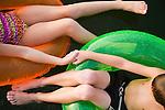 USA, Missouri, Stockton, Stockton Lake, boy (6-7) and girl (8-9)  swimming in inflatable rings