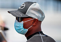 Jul 10, 2020; Clermont, Indiana, USA; NHRA top fuel driver Antron Brown wears a face mask during testing for the Lucas Oil Nationals at Lucas Oil Raceway. This will be the first race back for NHRA since the COVID-19 pandemic. Mandatory Credit: Mark J. Rebilas-USA TODAY Sports